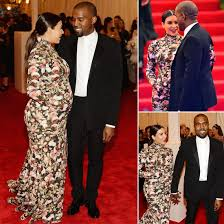 Kim donned a floral Givenchy by Riccardo Tisci Met Gala gown to make her inaugural appearance,